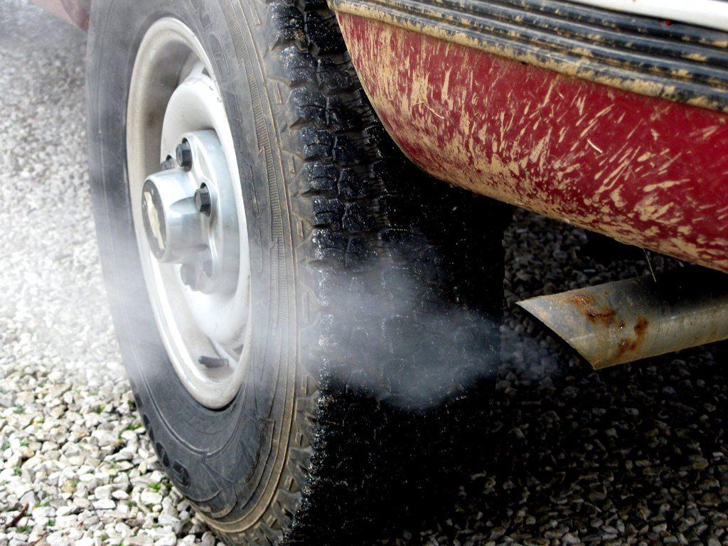 blue black white grey exhaust smoke from car
